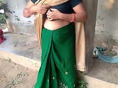 Desi Indian Mummy with a big exasperation milks her own Bristols in a farm-toun