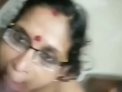 Mature mallu mom giving blowjob together with taking spunk in mouth