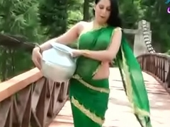 Roopi Shah Paki slut without blouse - teat showing in bedraggled saree- Desimasala.co